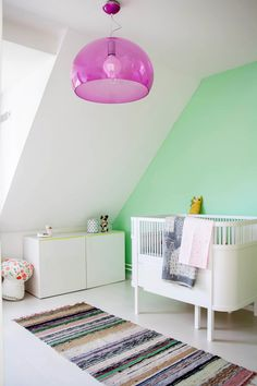 A colorful setting with Fl/y lamp by Ferruccio Laviani
