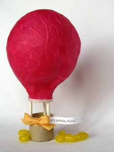 mini paper mache hot air balloon...the basket she used is ok, but I'd love to work in some pint-sized basket weaving