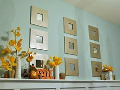 Create warmth by spray-painting inexpensive, wood mirror frames with metallic spray paint. Hang in a grid pattern behind pumpkins and fall leaves for a contemporary-meets-traditional look. Design by Lani Ariani