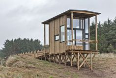 This wooden viewing cabin is raised on stilts above the rugged landscape of southern Norway