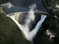 The Verzasca Dam, completed in 1965, is renowned for its beauty and its slender concrete arch. The design used less concrete than comparable dams, resulting in lower construction costs. When its reservoir was filled, small earthquakes were triggered.
