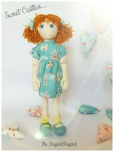 Beautiful handmade one of a kind rag doll  Sweet Castle Rags... This beautiful girl is a sheer delight... She has Lovely little red head has blue eyes her hair tied in bunches with teal ribbons. Her dress is teal with lovely princess castles. she wears yellow and white stripe fally down socks with little matching teal shoes.  About our dolls All of our dolls are beautifully hand crafted, completely unique members of the ever expanding RagdollRagdoll family. Measuring approximately 18…