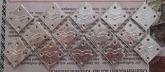 Pewter tablet weaving cards with heraldry.
