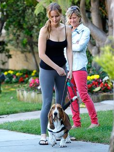 """JENNIFER LAWRENCE walking her dog in the MTX tapered pant featured on """"Stars and Their Pets"""" at People Magazine."""