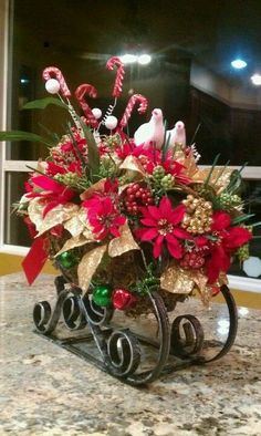 Ideas for Christmas Centerpieces come from a number of unique sources. Christmas Flower Arrangements, Christmas Flowers, Christmas Wreaths, Christmas Ornaments, Christmas Sleighs, Christmas Tabletop, Christmas Table Decorations, Christmas Interiors, Handmade Home