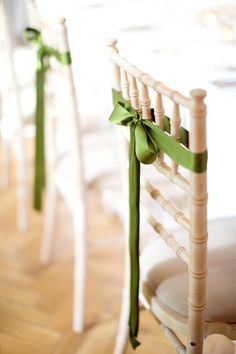 simple green ribbons decorating wedding chairs | fabmood.com