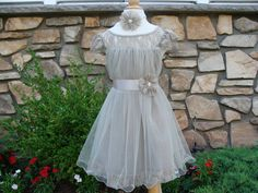 Thank you for visiting my shop.    From this listing you can choose dress with sash or dress, sash and headband.  Available colors are ivory, white ,