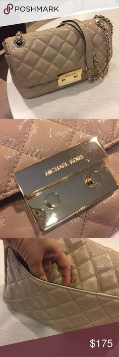 Michael Kors Purse Great condition no stains inside or in the front of the bag some jean marks in the back side nothing bad they can be cleaned. Shoulder or crossbody used just for vacation trip Michael Kors Bags