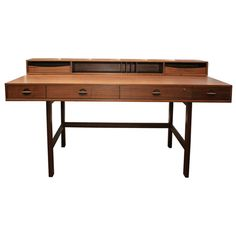 Danish Modern Teak Wood Flip Top Writing Desk by Jens Quistgaard - I do in fact own this desk. It was my father's. He had two, one in his home office and one in his dental office. When I took over his study (after sibling #4 was born) the desk became mine. It's still mine. Love the mid-century modern lines of it.