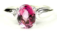 SR058, 9x7mm Pure Pink Topaz, 925 Sterling Silver Ring * Stone Type - Pure Pink Topaz * Approximate Stone Size - 9x7mm  * Approximate Stone Weight - 2.3 ct  * Jewelry Metal - Solid .925 Sterling Silver  * Approximate Metal Weight - 2.4 grams  * Ring Size - Size selectable during checkout * Our Warranty - A full year on workmanship  * Our Guarantee - Totally unconditional 30 day guarantee