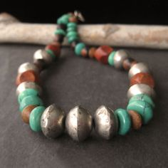 Earth and Sky Antique African Silver Trade Beads, Mixed Tropical Wood, Green Turquoise Contemporary Ethnic Rustic Necklace (N7) by ArtistaTree on Etsy https://www.etsy.com/listing/68369223/earth-and-sky-antique-african-silver