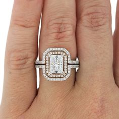 a double halo engagement ring made in white gold with a rose gold diamond at the center.