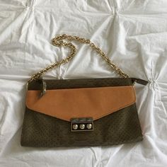 Henri bendel leather purse Small handbag with gold shoulder strap. Amazing detail on hardware. Additional sipper compartment inside. Moss green and cognac. henri bendel Bags