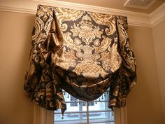I love fancy window treatments. I'd prob choose a different/softer pattern, but I love the shape.