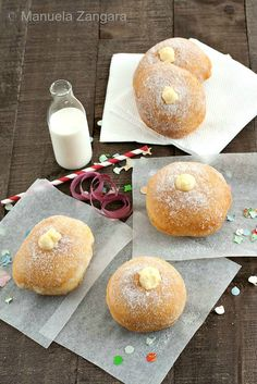 Bomboloni alla Crema - Italian fried doughnuts filled with pastry cream and coated with caster sugar. #Carnevale
