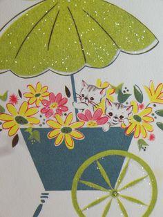 kitties in a cart