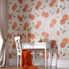 Our exquisite orange floral wallpaper will bring the brightness of a summers day to almost any room. This delightful design showcases a stunning palette of warm terracotta orange and cream, with simple and stylised line-drawn stems and leaves that create a soft, flowing feel, while the flowers themselves are highlighted and accentuated with dazzling and luxurious metallic halos. The perfect choice for sitting rooms, dining rooms and bedrooms alike.