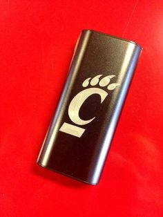 Plusblue custom engraved portable charger with UC logo. Charge up at all UC sporting events
