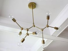 MOLECULE CHANDELIER The Molecule Chandelier lends a sculptural glow to your abode. Featuring 7-bulbs, this fixture provides ample light and is