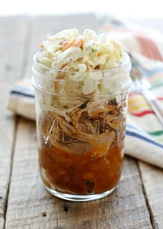 Pulled pork, baked beans, and southern-style coleslaw are layered together to make these Barbecue Sundaes - get the recipe at barefeetinthekitchen.com