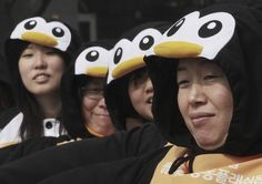 South Korea    Women wearing penguin costumes participate in a campaign to announce International Women's Day in Seoul, South Korea, March 7.