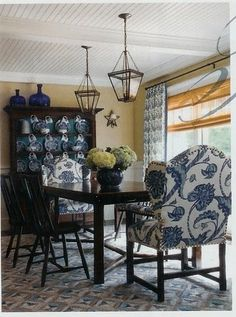 blue and white nailhead trimmed wing back chairs, lanterns, ceiling... gracious dining room