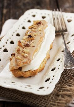 Maple Mascarpone Eclairs - maple glazed, topped with walnuts and filled with mascarpone whipped cream. | Seasons and Suppers