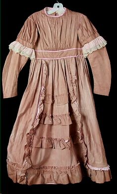 Girl's light brown cotton dress with pink cotton trim, 1870 - 1875, Wisconsin Historical Society