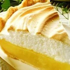 """Still a favorite---Magic Lemon Pie . created in the early this pie was touted as """"magic."""" Adding lemon juice to Eagle Brand creates a rich, creamy filling, without cooking, that is easy to make, delicious every time and never fails! Lemon Pie Recipe, Lemon Recipes, Pie Recipes, Sweet Recipes, Cooking Recipes, Mom's Recipe, Easy Lemon Pie, Recipe Photo, Recipies"""
