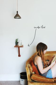 Poppytalk: DIY Wall Mount Side Table -- a tiny shelf would work next to the boys beds
