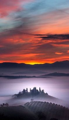 Tuscany, Italy. Looks like a magic castle  and village peeking out of the misty clouds :)