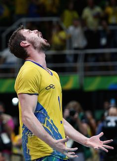 Bruno Rezende of Brazil celebrates after winning the Men's Gold Medal Match…