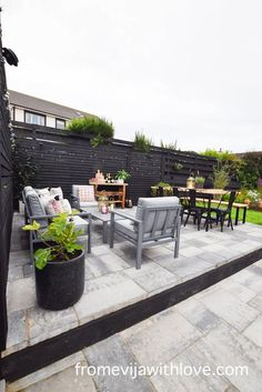 Garden Patio Area makeover, custom built black wooden privacy screen, grey slabbed area. Garden Slabs, Black Metal Chairs, Gold Lanterns, Fence Lighting, Large Planters, Amazing Spaces, Diy Patio, Dining Table Chairs, Outdoor Cushions
