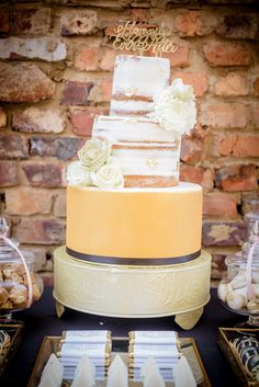 A beautiful golden wedding cake for a classic splendid occasion We were so honored to work with amazing suppliers! Check it out! Our incredible suppliers: Hair and Makeup - Style Productions Flowers and Decor - Casablanca Manor www.casablancamanor.co.za Cake and Desserts - L's Creations Stationary - The Little Blue Owl Photographer - The Girl With The Camera Video - Heinz Boesenberg Films D