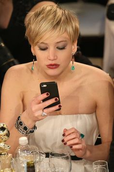 This candid of J. Law at the 2014 Golden Globes offers a great look at the star's fabulous vintage jewels.