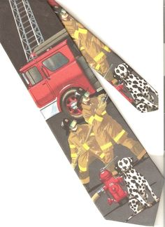 The tie is colorful with a novelty scene of firemen, dalmatian dog, fire truck and a fire hydrant. All firemen deserve a good tie!   eBay!