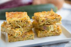How to Make An Amazing Zucchini Slice. This zucchini slice recipe only needs a few ingredients and it is super easy! You'll love having a zucchini slice! Zucchini Breakfast, Breakfast Cake, Breakfast Recipes, Zucchini And Carrot Slice, Freezer Cooking, Cooking Recipes, Vegetable Slice, Sweet Potato Slices, Easy Family Meals