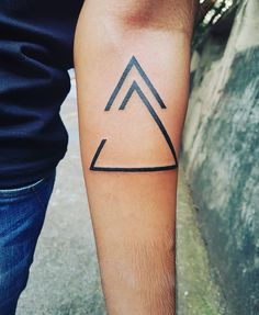 """The open delta represents a particular trait ie. Always open to change.The arrow above is one of my favorite viking symbol that states """"create your own and move forward"""". The 3 vertices of the delta depict each member of my family and the fourth vertice is for my pupper."""