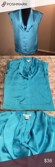 "Calvin Klein Teal Satin Blouse Cowl Neck EUC!! Only worn twice!! Size Small, BEAUTIFUL Calvin Klein blouse with tailored hem and gorgeous draped cowl neckline. Pair with a nice pencil skirt, black slacks, skinny pants...wear under a blazer or sweater jacket!! Absolutely CLASSIC piece that's versatile!! No stretch or ""give"" in this fabric!  Can fit a size 4-8 more petite top and hips. BUNDLE W/Black & Cream Calvin Klein Blouse in separate listing in my closet to SAVE!! Calvin Klein…"