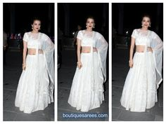 surveen chawla in white embroidery lehenga