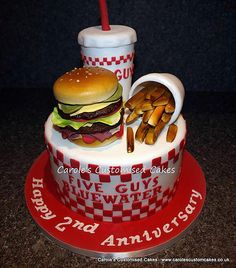 Carole's celebration cakes and birthday cakes Five Guys burger and fries cake for the Bluewater shop's second anniversary celebrations. Sugarpaste burger cake topper with sugarpaste fries.