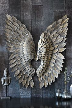 Use these Feather Effect Metallic Wings as a fabulous alternative to traditional wall art Hang them above your fireplace bed or in a child s room for
