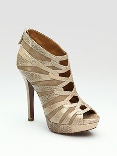 elie tahari shoes...love 'em but I doubt I could handle wearing these for long!  Much less walking in them...