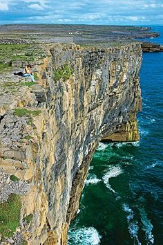 """Ireland Coast and Sea - No guardrail obstructs the 300-foot drop to the Atlantic ocean near Inishmore's Dun Aengus fort, which the 19th century painter and archaeologist George Petrie called """"the most magnificent barbaric monument in Europe."""""""