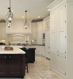 PRASADA white kitchen with large decorative wood hood and cherry island. www.prasadakitchens.com