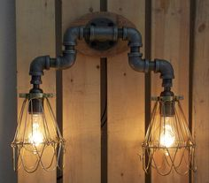 This two bulb industrial style wall mounted vanity light will look great in any application you choose. Made from black iron pipe and solid
