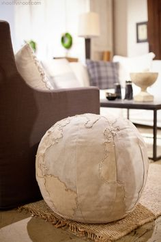 "Atchison Home |a ""tattered"" Globe Pouf"