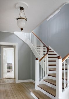 Older wooden cottage turned into a gem of a modern year-round residence Stairs Ideas cotta cottage gem Modern Older Residence turned wooden yearround Stair Railing Design, Home Stairs Design, House Design, House Staircase, Staircase Remodel, Hallway Colours, Wooden Cottage, Hallway Decorating, Historic Homes