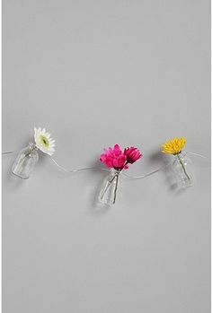 Bottle vase garland-- cute! I need these.  My space is butterflies and flowers