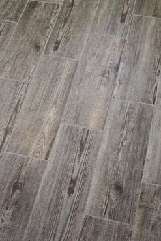 Bathroom tile that resembles old wood. Did   this in Bruce's moms basement but darker! Love these tiles!